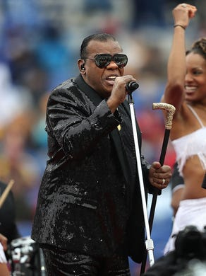 """Ronald Isley (center) and Ernie Isley (right) with the Isley Brothers perform """"Twist and Shout"""" during the halftime show at the 59th annual Liberty Bowl in Memphis Saturday."""