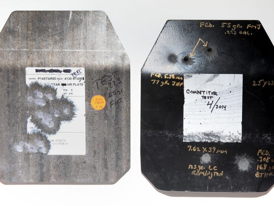 A Copgear steel test plate, at left with 223mm riffle rounds shot at it with ricochet marks and a competitor's steel with the same 223mm rounds that penetrated the steel plate at the top left.