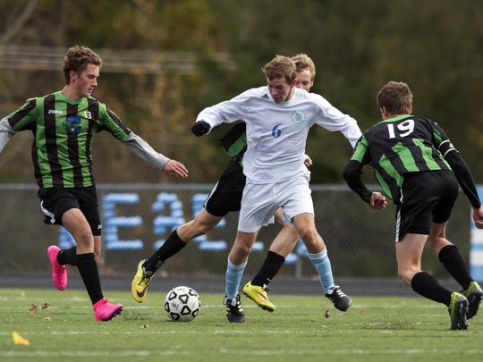 South Burlington's Patrick O'Hara (6) and Colchester's