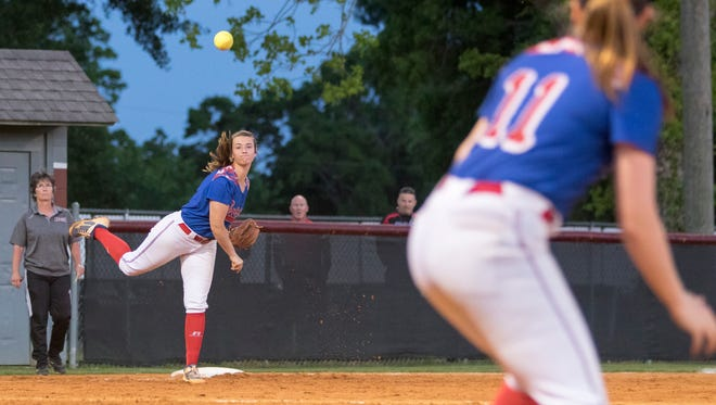 Third baseman Kenna Coleman (7) throws to first for an out during the district championship softball between Tate and Pace high schools at Tate High School on Thursday, April 26, 2018.