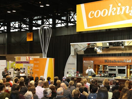 Hundreds watched chef Rick Bayless demonstrate new and innovative ways to cook during the International Home + Housewares Show at Chicago's McCormick Place.
