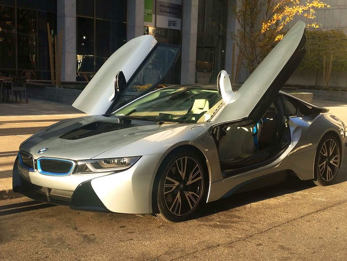 The 2014 BMW i8 is a mid-engined, plug-in electric,