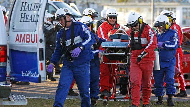 Rescue workers move Memo Gidley to an ambulance after they extricated him from his car following Saturday's crash at the Rolex 24 at Daytona.