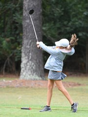 South Gibson County's Rachel Tiger tees off during