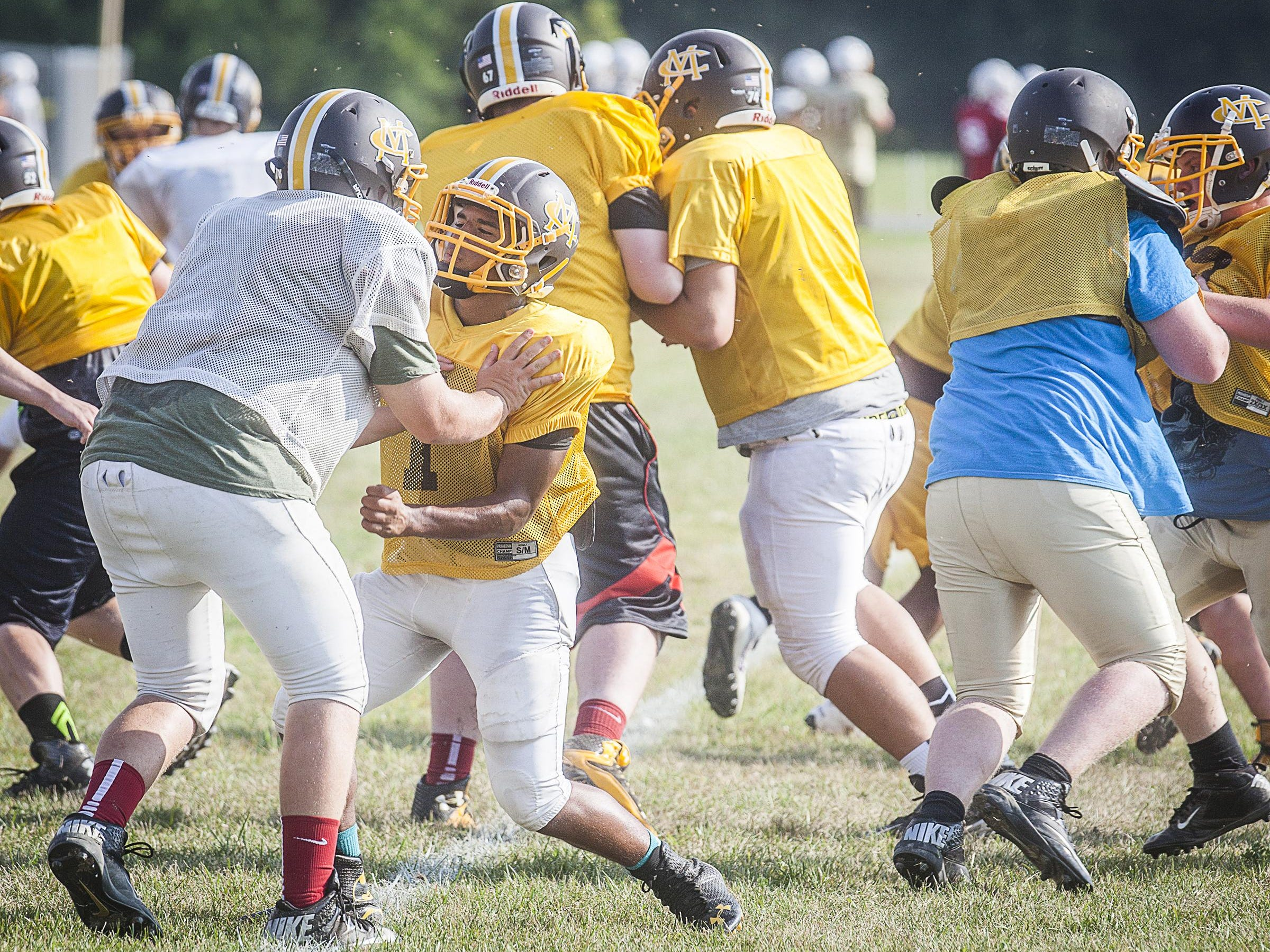 Monroe Central's Tyler Writtenhouse blocks during a drill at Monroe Central High School Tuesday.