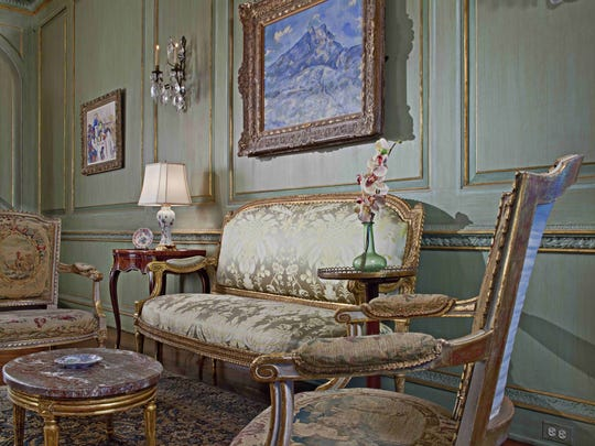 "Visitors to the Edsel & Eleanor Ford House in Grosse Pointe Shores could see Cézanne's oil painting ""La Montagne Sainte-Victoire vue du bosquet du Château Noir"" hanging above the sofa in the drawing room."