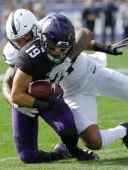 Penn State safety Marcus Allen, right, tackles Northwestern wide receiver Riley Lees during the first half of an NCAA college football game in Evanston, Ill., Saturday, Oct. 7, 2017. (AP Photo/Nam Y. Huh)