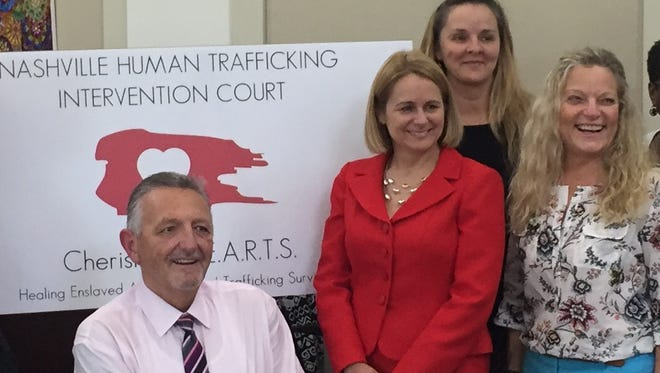 Former Judge Casey Moreland, Assistant District Attorney General Tammy Meade, Shelia Simpkins of End Slavery Tennessee and Assistant District Attorney General Deb U. Smith, who operate Cherished HEARTS, Nashville's human trafficking intervention court, pose for a photograph Aug. 23, 2016, after the first graduation from the program.