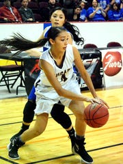 Cibola's Tiana Guillory tracks down the ball against Carlsbad's Caitlin Carrasco in the second quarter Thursday.