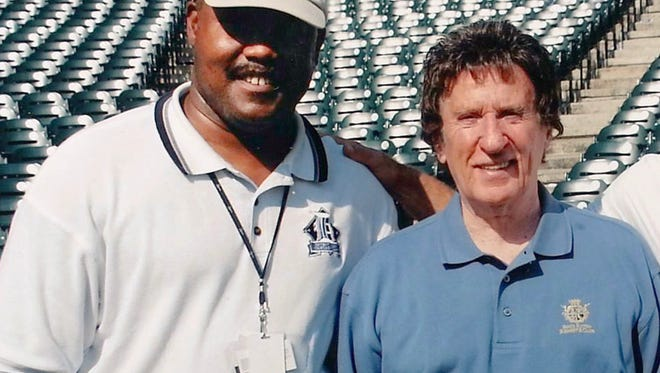 Cliff Russell is photographed with Detroit Tigers owner Mike Ilitch while at Comerica Park the summer of 2004.