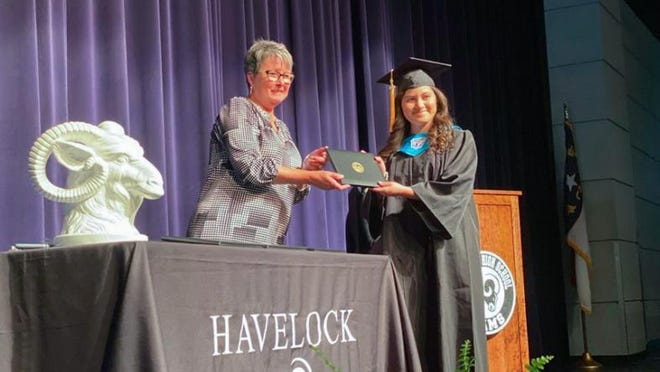 A Havelock High School senior receives her diploma from Principal Stacie Friebel during the school's non-traditional graduation at the Havelock Performing Arts Center June 1-3, 2020.