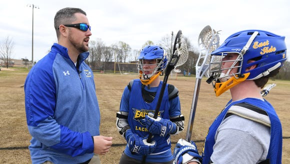 Mike McCallan, left, a Long Island native, has led Eastside to the playoffs each of his first two seasons as the Eagles' boys lacrosse coach. He's coaching this season six months after undergoing brain surgery.