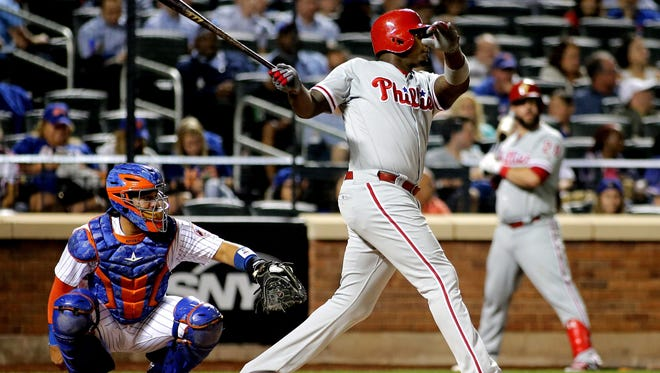 Phillies first baseman Ryan Howard hits a solo home run against the New York Mets during the fifth inning at Citi Field. Thursday was the first of seven games the Phillies play against the Mets to close out the season.