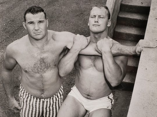 Former Tennessee defensive lineman Doug Atkins, left,  is pictured with Jack Stroud on July 15, 1959. Atkins, a member of both the College and Pro Football Hall of Fames, died Wednesday, Dec. 30, 2015, at age 85.