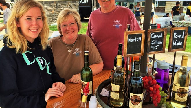 Manning the Coral Cellars Micro-Winery booth at the season's first North Liberty Farmer's Market were Holly, from left, Carol and Brian Manternach.