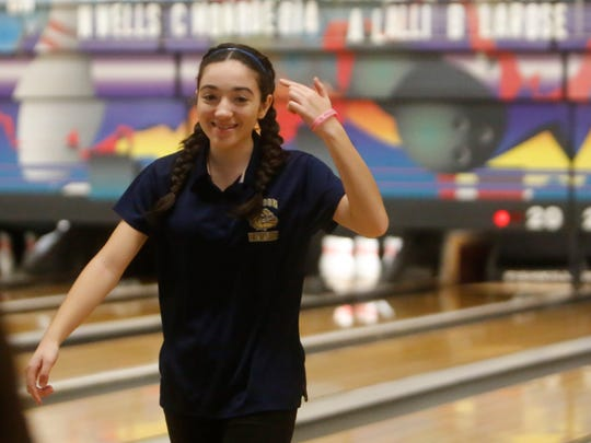 Beacon's Selena Virtuoso reacts after scoring a strike during the Section 1 girls bowling tournament at Fishkill Bowl in Fishkill on Feb. 12, 2018.