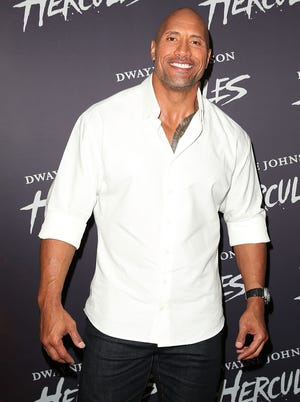 "Dwayne Johnson arrives at the screening of ""HERCULES"" at Event Cinemas George Street on June 19, 2014 in Sydney, Australia."