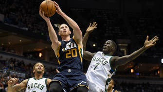 The Utah Jazz's Gordon Hayward  shoots against the Milwaukee Bucks' Thon Maker (right) and Michael Beasley Friday.