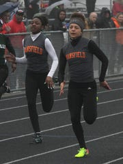 Mansfield Senior's Alaysia Grose (right) beats teammate Jakari Brown to the finish line in the 100 meter dash of Friday's Madison Invitational. Grose was a quadruple winner.