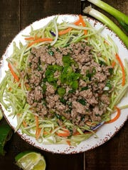 A full serving of Thai pork salad comes in at only 218 calories.