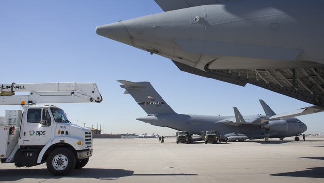 An APS bucket truck is loaded into a C-17 at the Sky Harbor Air National Guard Base in 2012. The base is being renamed after Barry Goldwater.
