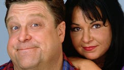 John Goodman, left, and Roseanne Barr, seen in a 1990s