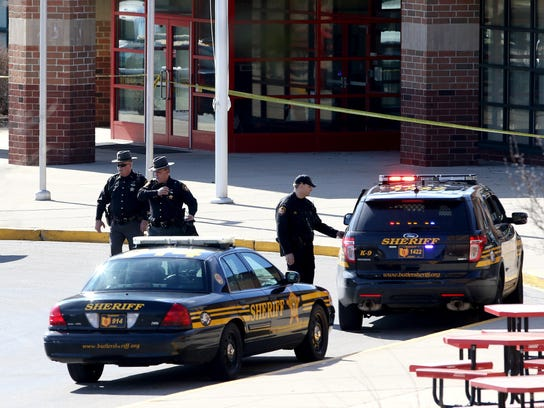 Authorities from the Butler County Sheriff's Office investigate a shooting at Madison Jr./Sr. High School in 2016.
