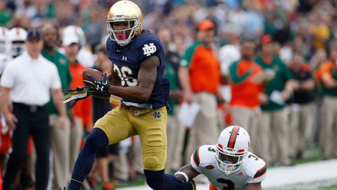 Oct 29, 2016; South Bend, IN, USA; Notre Dame Fighting Irish cornerback Cole Luke (36) intercepts the ball and is chased by Miami Hurricanes wide receiver Stacy Coley (3) at Notre Dame Stadium. Mandatory Credit: Brian Spurlock-USA TODAY Sports