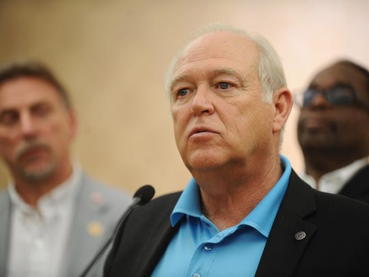"""UAW President Dennis Williams, seen in 2013, is touting a """"Buy American"""" advertising campaign, while being flanked by UAW Vice President Norwood Jewell, left."""