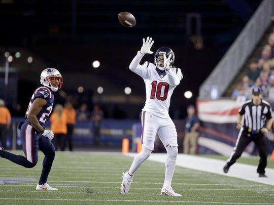 Houston Texans wide receiver DeAndre Hopkins (10) catches