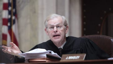 This June 6, 2011 photo shows Wisconsin Supreme Court Justice David Prosser posing a question to Dane County Circuit Court Representative Marie A. Stanton during a hearing at the Wisconsin State Capitol. Prosser announced his retirement Wednesday, April 27, 2016, in a news release from the court.