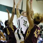 Acadiana's Amy Comeaux (30) puts up a shot as Natchitoches-Central's NuNu Payton (50) and Hailey Sanchez (43) defend during the Lady Rams' loss Monday.