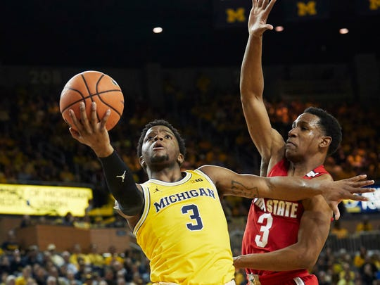 Zavier Simpson shoots against Ohio State's C.J. Jackson last season.