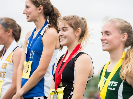 Delone Catholic's Leanne Sneeringer smiles on the podium after finishing second in the 2A girls' 800 meter run during the PIAA District 3 track and field championships at Shippensburg University on Saturday, May 20, 2017. Sneeringer claimed the silver medal with a time of 2:24.57.