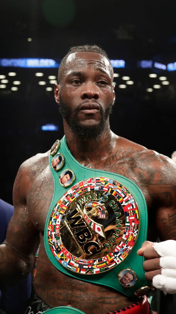 Deontay Wilder poses for photographs after the WBC