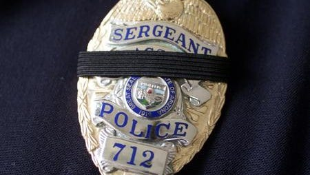 Badge like those worn after the loss of an officer.