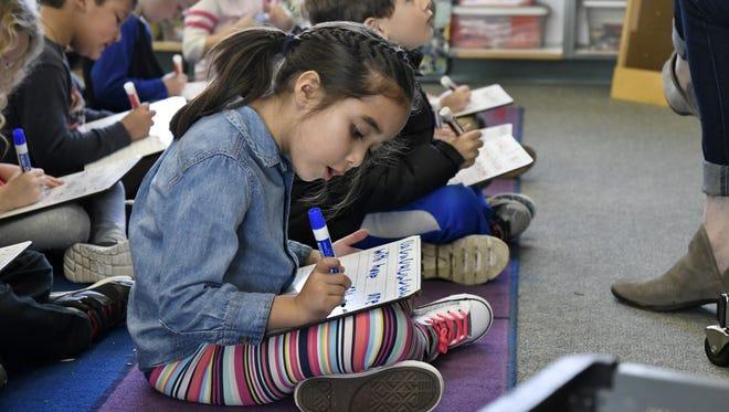 A Hurley Elementary School transitional kindergarten student practices spelling at the Visalia school Wednesday morning.