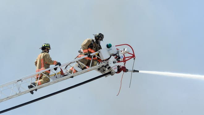 Reno firefighters use an aerial truck to battle a May 29 pallet fire in Stead. Reno firefighters use an aerial truck to battle a pallet fire on Bravo Avenue in Stead Thursday May 29, 2014.