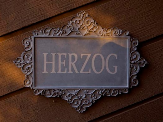 There's no mistaking whom you're calling on when stepping up to the front door of Local 12 news personality Bob Herzog's West Side home.   The family has lived on a remote Green Township cul-de-sac for five years, and although Herzog says his house might be more on the regular side compared with his neighbors' houses, it's the perfect home for his friendly family.