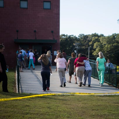 People gather at Townville Elementary School on Wednesday