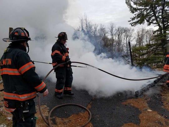 Firefighters battle the fire at Dutchess Golf Club