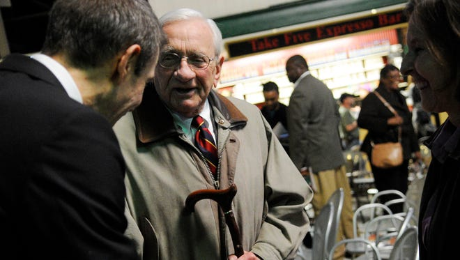 World-renown artist and York County native Jeff Koons, left, talks with Louis Appell Jr. after the State of the City Address at Central Market in York in 2012. Koons, who was honored by Mayor Kim Bracey after her address that night, said that, after talking with Appell, he hoped to contribute to York's revitalization.