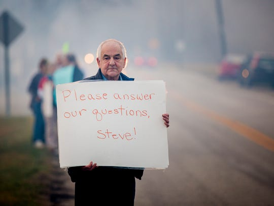 Rob Weidenfeld, of Sharonville, stands with protesters outside the VFW Duwel Post 7570 in Harrison, Ohio, before Congressman Steve Chabot speaks to the Greater Harrison Chamber of Commerce Thursday, February 23, 2017. Protesters and attendees are asking Chabot to hold a town hall to meet with this constituents.