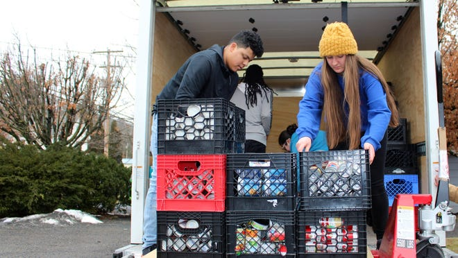"Pleasant Valley High School seniors Jessie Mieles, left, and Andrea Janak unload a truckload of soup at the West End Food Pantry on Thursday, Feb. 7, 2019. The school district collected over 5,000 cans of soup as part of their ""Souper Bowl"" over the course of January."