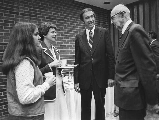 Dr. Jesse Fletcher (second from right) with Melissa Fletcher and his wife, Dorothy, speak with Dr. Rupert Richardson on Oct. 25, 1977.