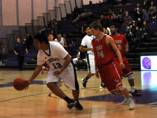 Carrizozo came out with the 61-57 win over Mescalero Dec. 8.