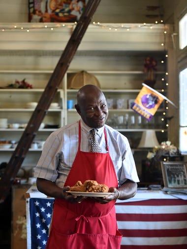 "Arthur ""Mr. D"" Davis holds a plate of his famous fried"