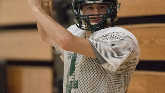 Quarterback Joe Duty throws during Adams-Friendship football practice, Thursday, Aug. 4, 2016. The football team was holding practice indoors due to weather.