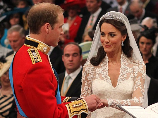 Prince William and Kate Middleton exchange rings during