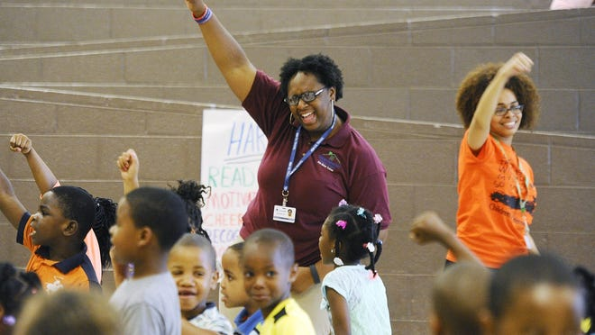 Hope Village Freedom School project director Claricha Evans and servant leader intern Andrienne Wells get the children motivated during the Hope Village Freedom School program 'Harambee' session which instead of keeping the children quiet and in their chairs, motivates the students with cheers, chants, motivational songs and dancing in Detroit, Michigan on June 22, 2016.